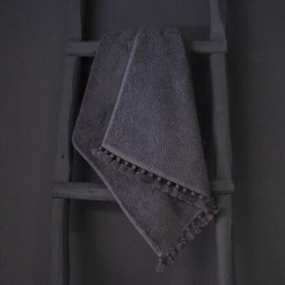 grey bath towel pompoms valerie barkowski