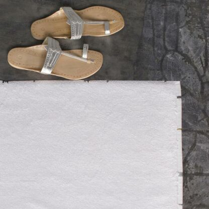 Hand-embroidered white bath linen bath mat