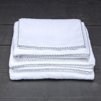 white thick terry towel with black hand embroidery