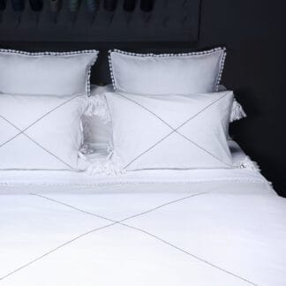 buy Cotton hand embroidered bed linen with fabric tassels