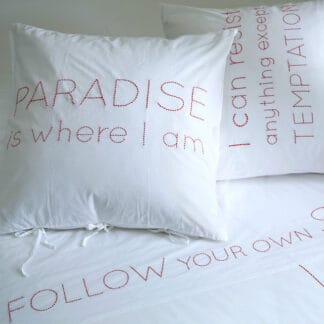 hand-embroidered bed linen with quotes