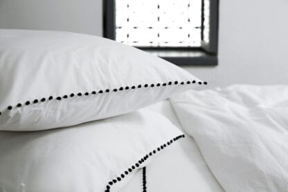 AYA bed linen with buttons embroidery
