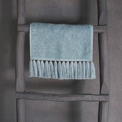 Luxury guest towel in pale blue terry with fringes
