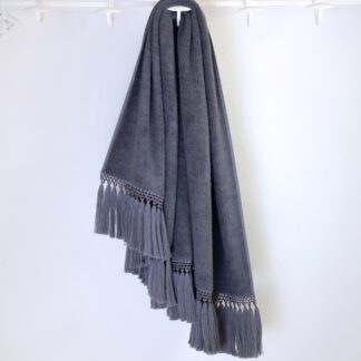 grey bath towel with grey pompoms