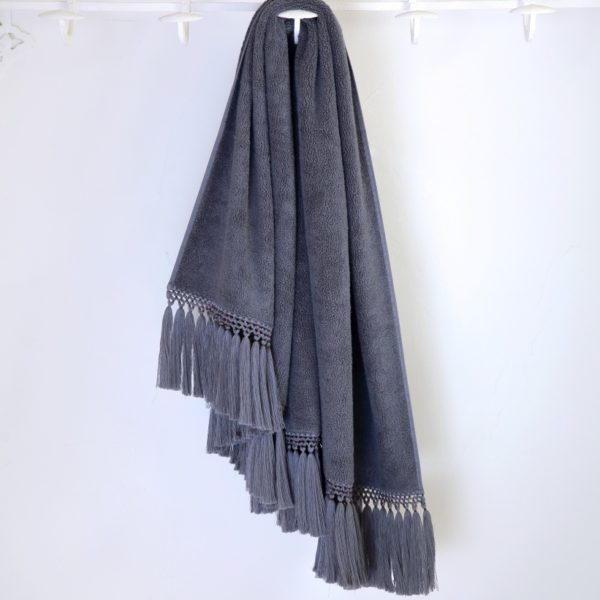 grey bath towel with grey pompoms