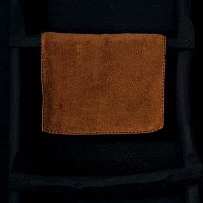 trass black handembroidery on amber guest towel
